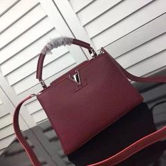 Сумка Louis Vuitton Capucines бордового цвета